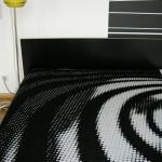 schwarz weiße Strickdecke St Oberholz Apartments